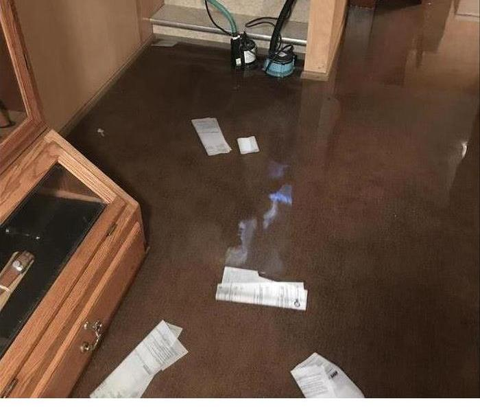flooded basement with water standing and papers floating
